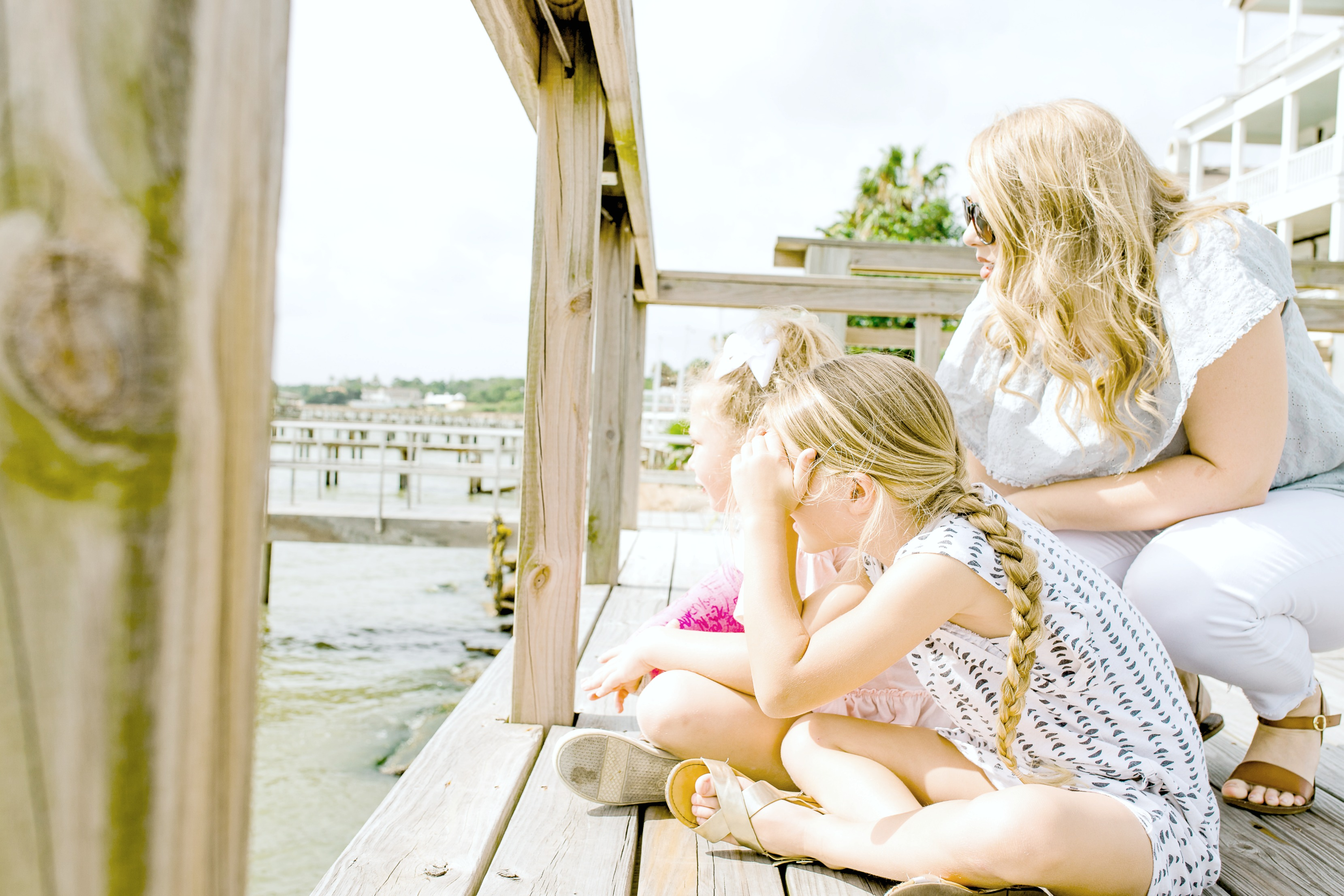 Mom and Daughters on the Dock in the Summer