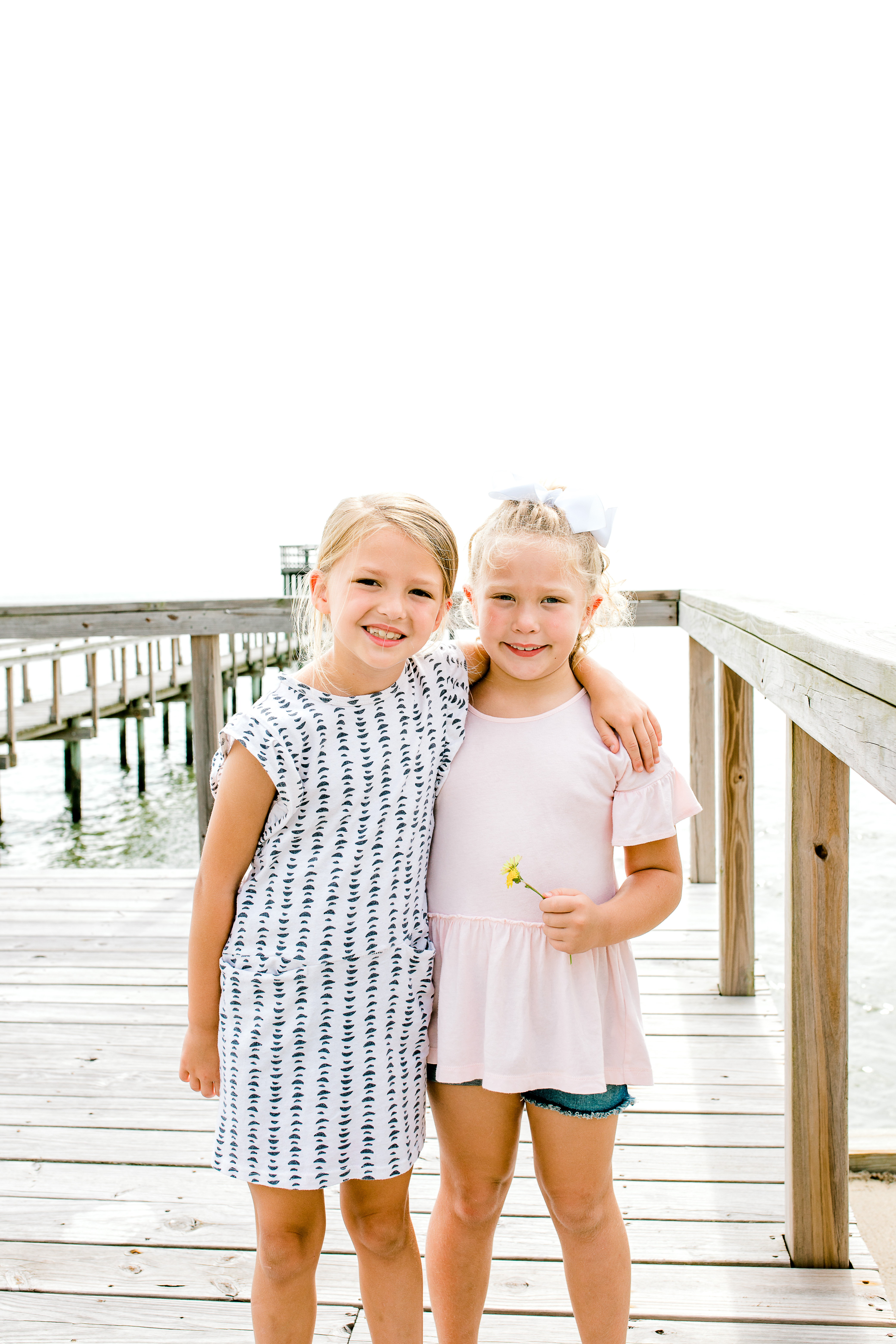Sisters Standing on the Dock in the Summer Heat